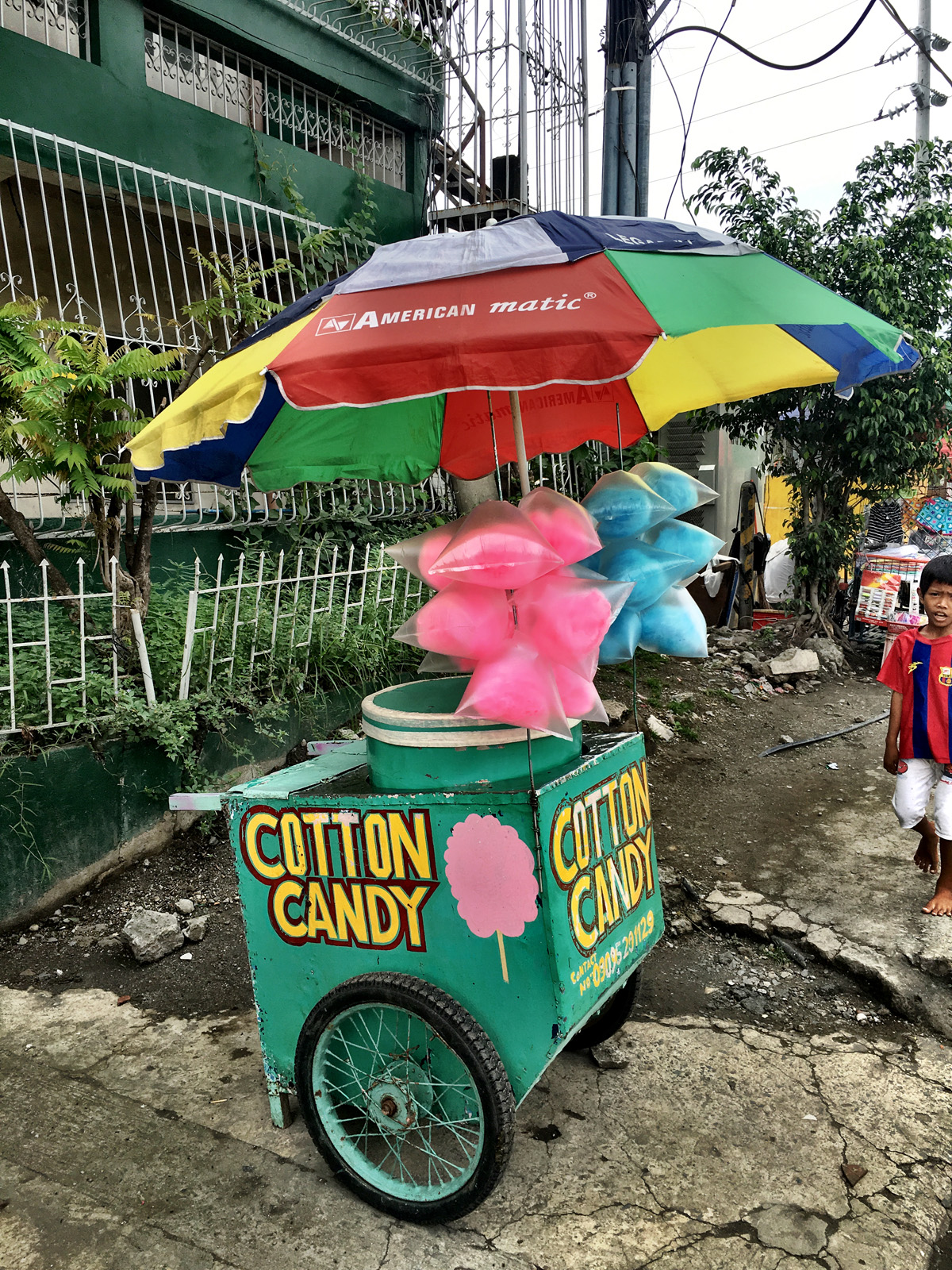 Cotton candy vendor on the side of the road.