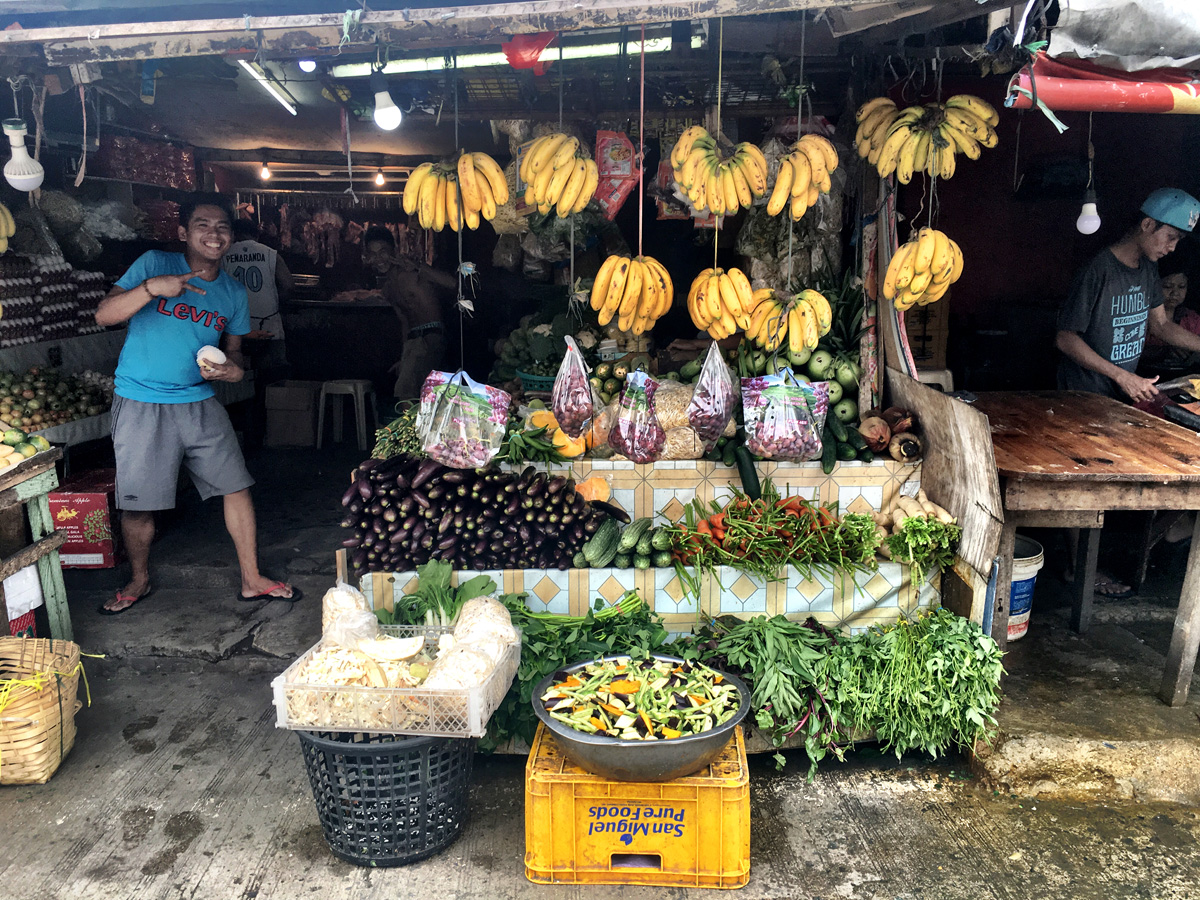 Street vendor selling fruits.